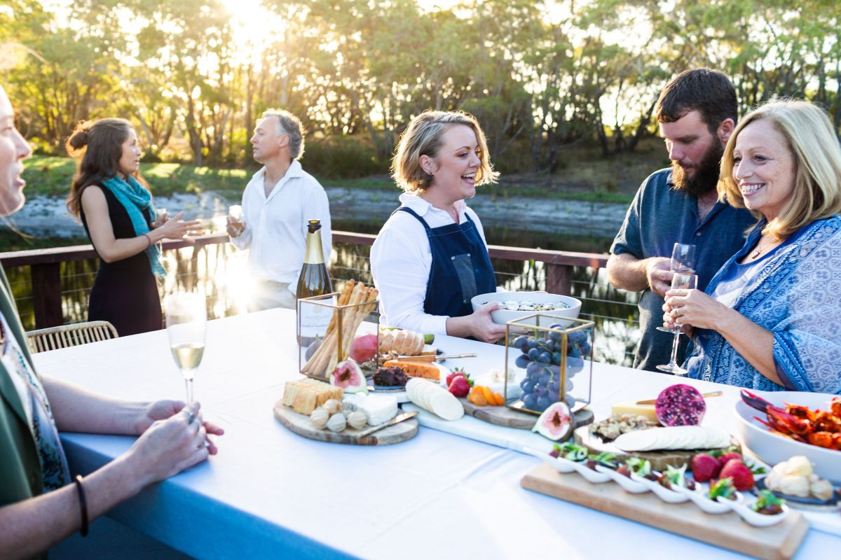 Wi L guests eating local food and wine on the South Coast Walk